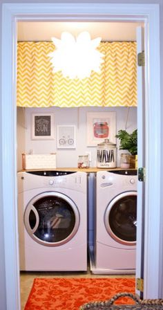 small laundry room makeover, Hoot Designs on Shanty2Chic. Love the idea of using a curtain to hide things on the shelf!