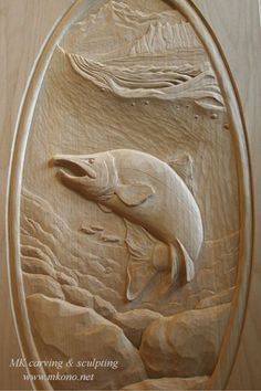 "Title: ""Salmon"", door carving  Material: Clear Alder  Panel size: WxHxD 19"" x 36"" x 1.5"""