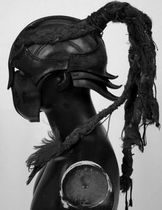 avant garde couture sculpted leather helmet-mask with ponytail - source not provided