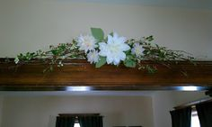 DIY Grapvine/floral swag. I made this to match my centerpieces and love it!
