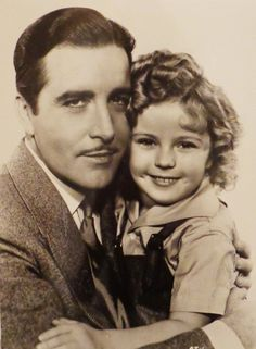 John Boles and Shirley Temple in Curly Top, 1935.