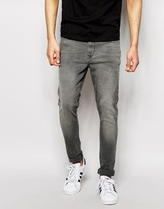 $51, Grey Jeans: Asos Brand Super Skinny Jeans In Light Gray Wash. Sold by Asos. Click for more info: https://lookastic.com/men/shop_items/303144/redirect
