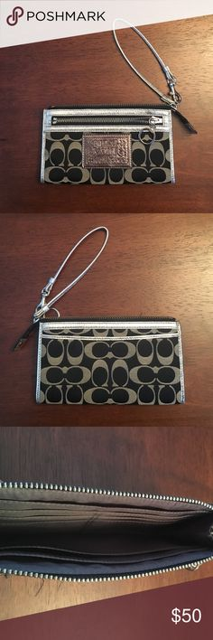 """Coach """"Poppy"""" wristlet Black and silver wristlet from the Coach Poppy Collection. Has multiple card pockets on the inside and two flat pockets on the outside (one zipper, one not) Coach Bags Clutches & Wristlets"""
