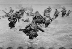 Normandy, France. 6 June, 1944. US troops assault Omaha Beach during the D-Day landings. Robert Capa © International Center of Photography