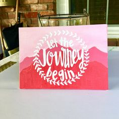 All of my pieces are HAND PAINTED & lettered by me! I put a lot of time and thought into each painting to ensure that you get a high quality piece of art. Let the Journey Begin 5x7 canvas board Light pink background, dark pink and red mountains, white lettering. This item is hand