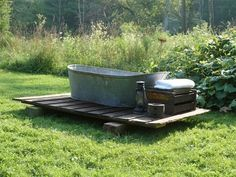 Pallet oasis...vintage galvanized tub, lantern, soda crate as bench for towels.