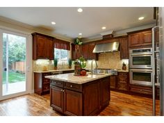 Beautiful counters with solid wood cabinets.