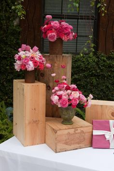 Old wine boxes stacked and used to bring different height levels to a display table.