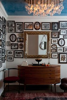 Stunning foyer with eclectic black & white photo gallery