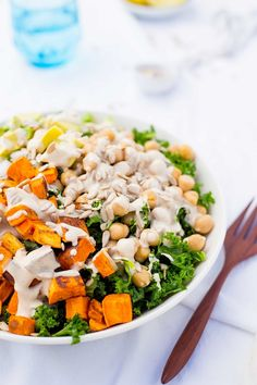 Kale Salad with Sweet Potato, Chickpeas & Avocado with Creamy Tahini Dressing.  The perfect filling lunch!