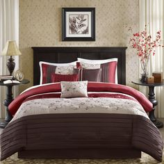 The Belle bedding collection provides an elegant look to your home. The top of the duvet cover is a mix of rich red, chocolate brown, and ivory with piecing details.