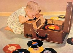 Precious little boy listening to records.