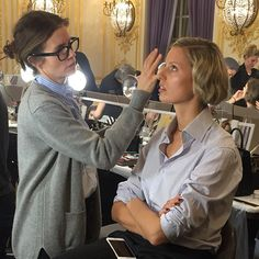 Makeup artist #gucciwestman puts the final touches to models backstage at the #MarchesaFashion show. #FW15 #NFYW #NETAPORTERFrontRow