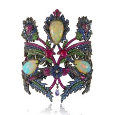 Lydia Courteille's Topkapi cuff, set with three Welo opals, tourmalines, aquamarines, rubies, tsavorites, sapphires and diamonds in black rhodium. Discover the exotic Topkapi royal collection with turkish inspiration and a lot of jewellery love: http://www.thejewelleryeditor.com/jewellery/article/lydia-courteille-topkapi-welo-opal-jewelllery-collection/ #jewelry