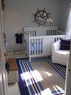 Nautical Nursery...too cute, I don't think Blake would go for it...too much Navy in our lives already lol