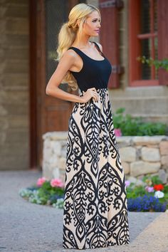 One of our best sellers! Designed by Chris for the ultimate in style and comfort! Sleeveless Maxi dress with damasak print bottom, unlined. This dress has an am