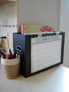 Great household management idea.  File box features monthly calendar, hanging folders for each family member's mail. Notebook holds task lists and meal planners in sheet protectors that can be written on with dry erase markers. Clever!