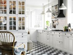 Traditional Kitchen by IKEA - digging the hardware.  Also the floor.