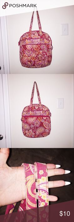 Vera Bradley Bag Description of item: It has two front pockets on the outside and a big back pocket. On the inside it has 3 smalls pockets and a laptop separator.  → Material: 100% Cotton → Made in China → Condition: Fairly used. The handles look used, but the bag has NO holes or stains.  • Offers Accepted • No trades Vera Bradley Bags