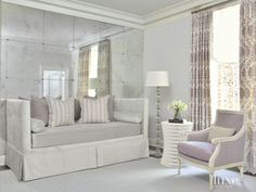 Contemporary White Bedroom with Mirrored Feature Wall