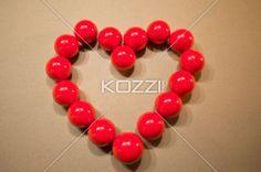 snooker balls forming heart shape. - Close-up shot of red shiny snooker balls forming heart shape.