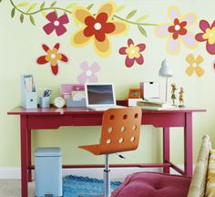 Flower Power  Fun and bold, these graphic painted flowers liven up the study area in this teen girl's room. The flowers were hand-painted freestyle in colors to coordinate with the bright furniture