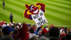 """While real Indians protest in North Dakota, another protest is happening -- watching the World Series and the fake """"chief"""" Wahoo, demonstrating how far we still have to go to fight stereotypes."""