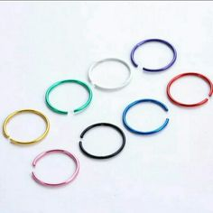 8 COLORED NOSE RING HOOPS 18G NEW Brand new. 1 of each color. 8 brand new sterlized nose ring hoops. Ships same or next day always Jewelry Rings