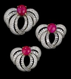 1955 Set of Three Clip Brooches worn by Princess Grace of Monaco by Cartier Paris: Platinum, brilliant- and baguette-cut diamonds, three cabochon rubies weighing approximately 49 carats. Via Palais Princier de Monaco.