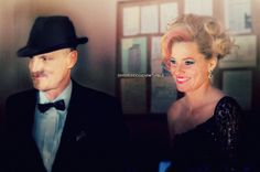 Haymitch and Effie finally found together at Katniss' & Peeta's wedding {after the Mockingjay epilogue}