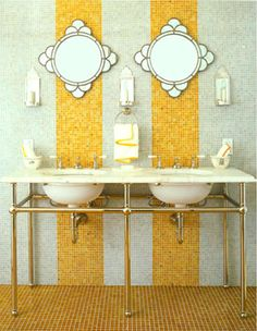 pretty bathroom, like the tile stripe, sink style, and shape of mirrors.