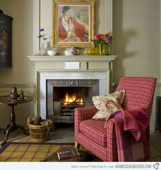 Tartan upholstery in fresh raspberry and orange lifts this living room and is teamed with earthier peat and charcoal shades. An elegant fireplace creates a warm and cosy look to snuggle up next to. A tartan rug warms the stone floor.