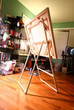 PVC Pipe Easel - Self Explanatory  @Heather Creswell Creswell Forster  here you go heather!  no more slippy chairs!