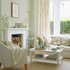 creamy white living room with accents of very light green and bluegreen and brown living room clear glass doors lighting in ceiling varnished wood floor t natural stone base clear glass wine cabinets interior decorationg