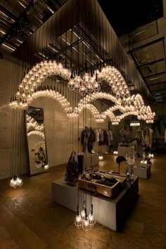 Ayako Maruta's stunning light installation at the Diesel Denim Gallery in Aoyama, Tokyo Lighting Retail Design Design Shop, Deco Design, Display Design, Design Light, Lighting Design, Commercial Design, Commercial Interiors, Blitz Design, Retail Store Design