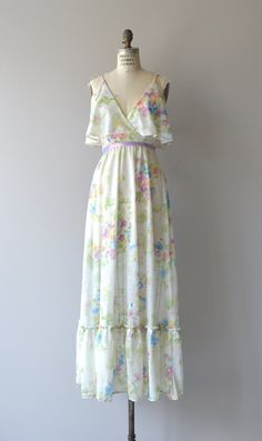 Vintage early 1970s floral nylon chiffon maxi dress with pastel floral print, faux wrap bodice, flouncy peplum bodice, ruffled hem, lined bodice,