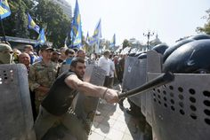 Demonstrators, who are against a constitutional amendment on decentralization, clash with police outside the parliament building in Kiev, Ukraine, August 31, 2015. Ukraine's parliament voted for constitutional changes to give separatist-minded eastern regions a special status - but divisions in the pro-Western camp and violent street protests suggested the changes would face a rougher ride to become law. REUTERS/Valentyn Ogirenko
