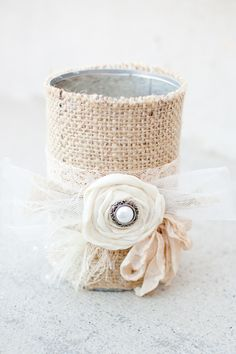 DIY Budget Wedding - tin cans, burlap, scrap fabric roses and a button.  All thrift store or garage sale finds!