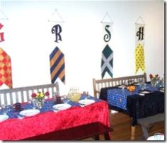table cloths in house colors, house banners on the wall