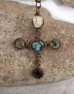 Cross wire pendant.