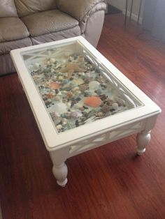 27 Amazing Ocean Coffee Table Design Ideas You Must Have For Living Room - Seashell Crafts, Beach Crafts, Shadow Box Coffee Table, Seashell Display, Coffee Table Design, Beachy Coffee Table, Coffee Tables, Beach House Decor, Home Decor