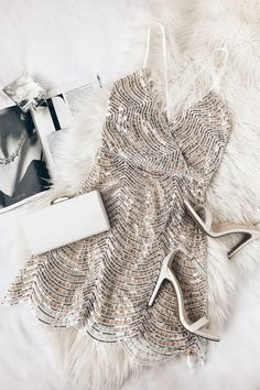 The Lele White and Silver Sequin Mini Dress is all about besties and bubbly! Shiny silver sequins and white embroidery create this mini dress. White And Silver Dress, Silver Sequin Dress, Sequin Mini Dress, White Dress, Nye Outfits, New Years Eve Outfits, Fashion Outfits, 90s Fashion, Classy Fashion