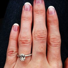 oval cut engagement ring!  this is EXACTLY WHAT I WANT!!!!! (minus the diamond band--just a simple one will do)