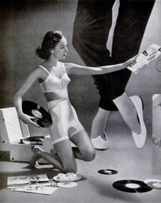 this lady, in the flats, is probably wondering what a miniature girl, in a miniature bra and girdle, is doing playing with miniature records on her floor.  (forget the meds, I wonder as well.)