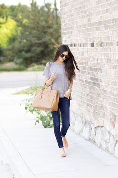 simple jeans and tshirt.. get rid of the bag and it's easily do-able
