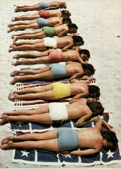 Vintage photo of topless Sun-tanning
