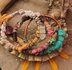 Traveler Soul- mixed media assemblage bracelets with textiles and random objects - rhinestones, lace, wire, crystal point, green skull bead, seed beads.