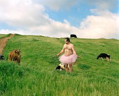 Man photographs himself in a pink tutu to help fight breast cancer.  He's publishing a book of his photos and donating proceeds to fight cancer.