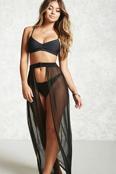 A sheer mesh swim cover-up maxi skirt featuring an open front, and a contrasting waist with a concealed front closure.