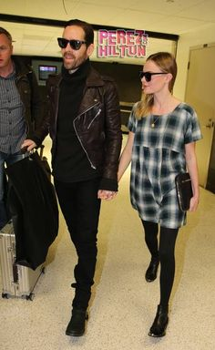 Kate Bosworth and Michael Polish arrive at LAX following London Fashion Week.
